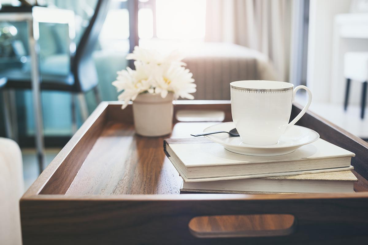 a cup of coffee sitting on top of a wooden table