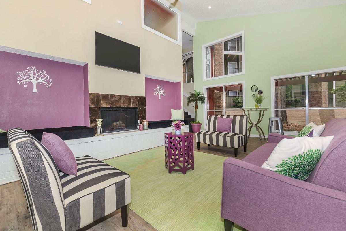 a living room with purple white and pink flowers