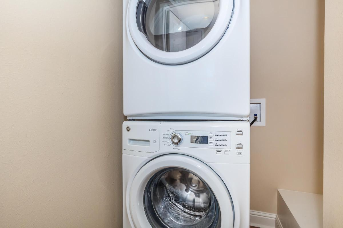 a white refrigerator freezer sitting in a dryer