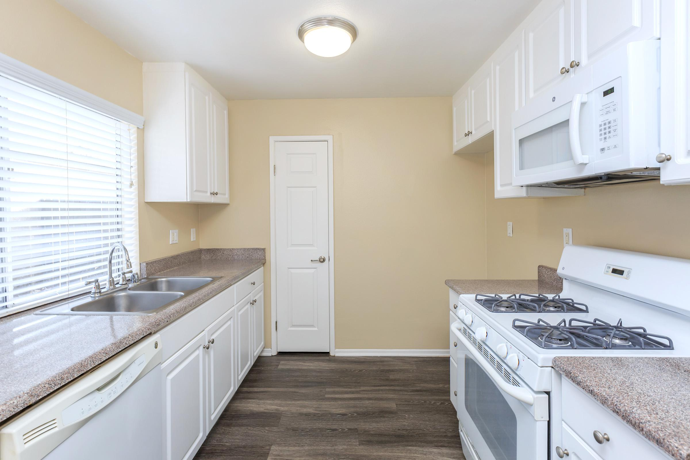 a kitchen with a sink and a bed