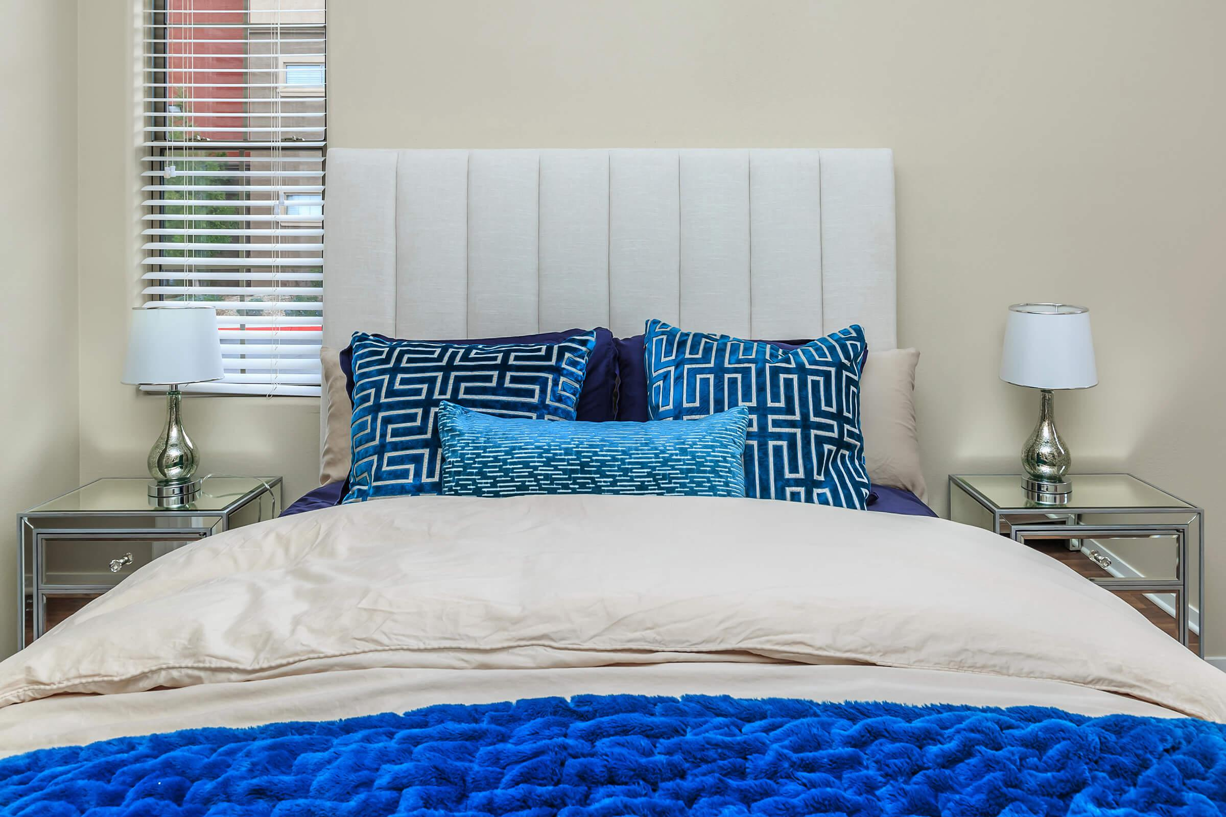 a blue and white bed in a bedroom