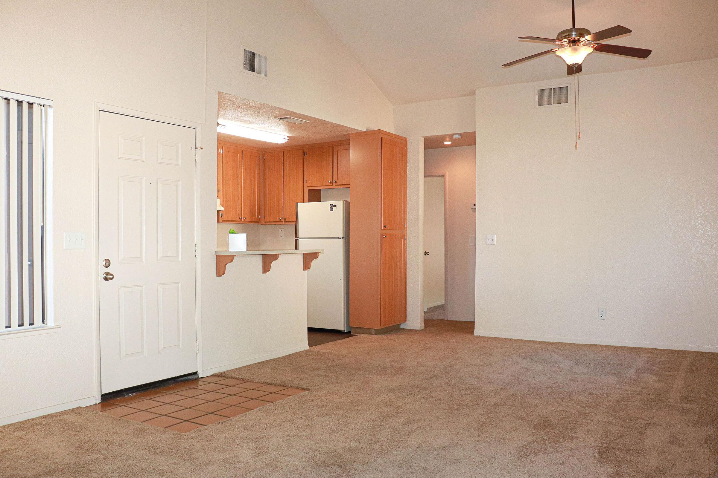 a white refrigerator freezer sitting inside of a house