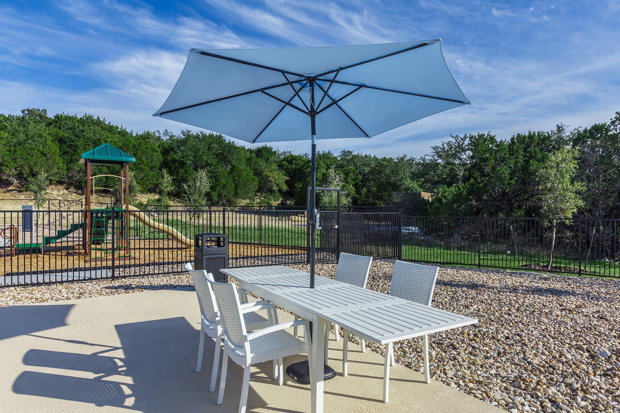 a lawn chair under an umbrella