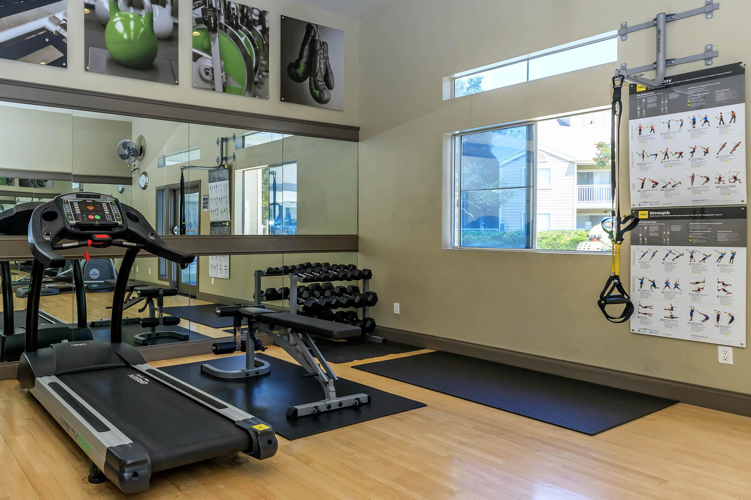 Cambridge Village Apartments community gym with mirrors