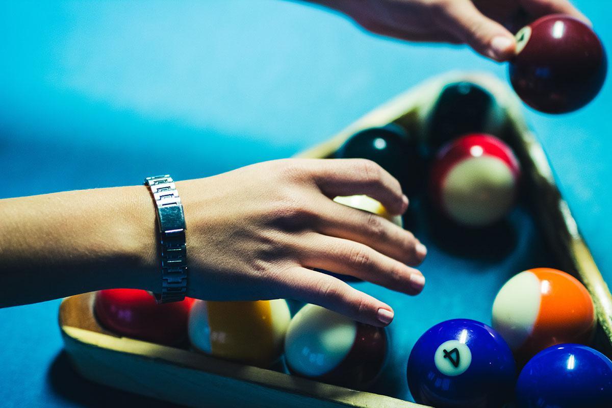 a hand holding a blue ball