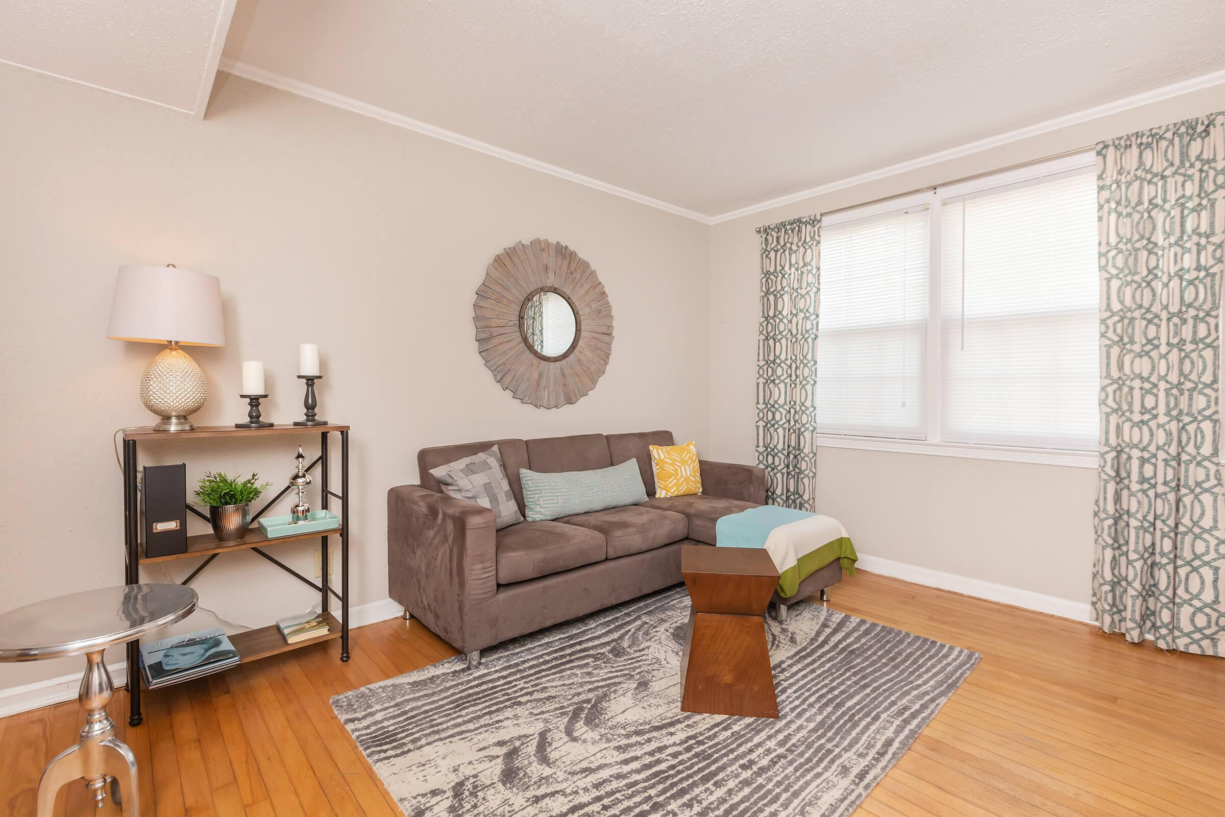 a living room filled with furniture and a large window