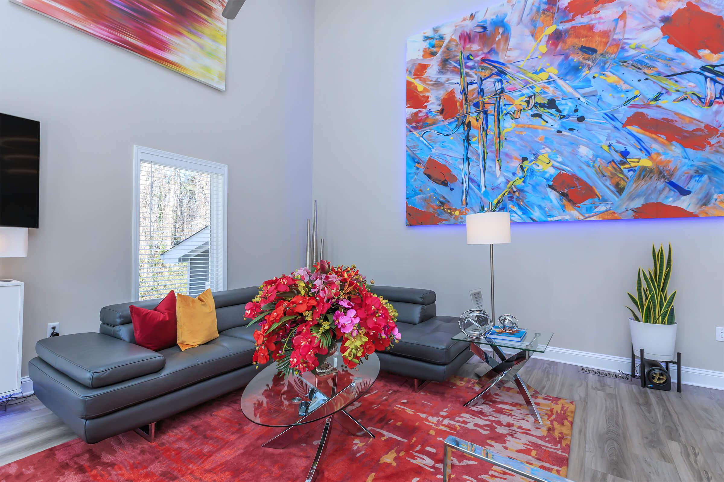 a living room filled with colorful flowers