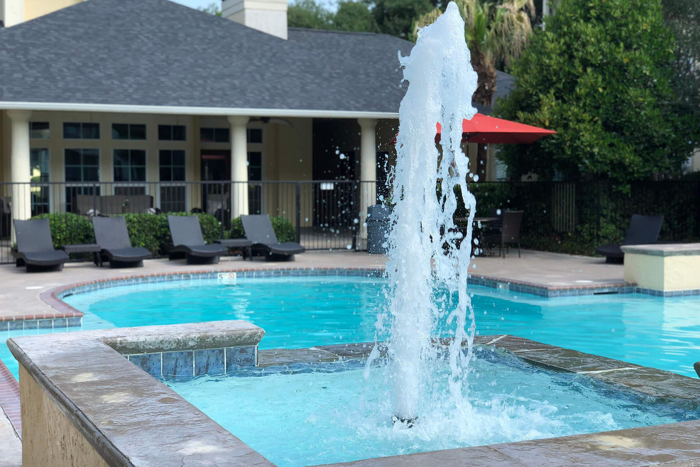 a fountain in a pool of water
