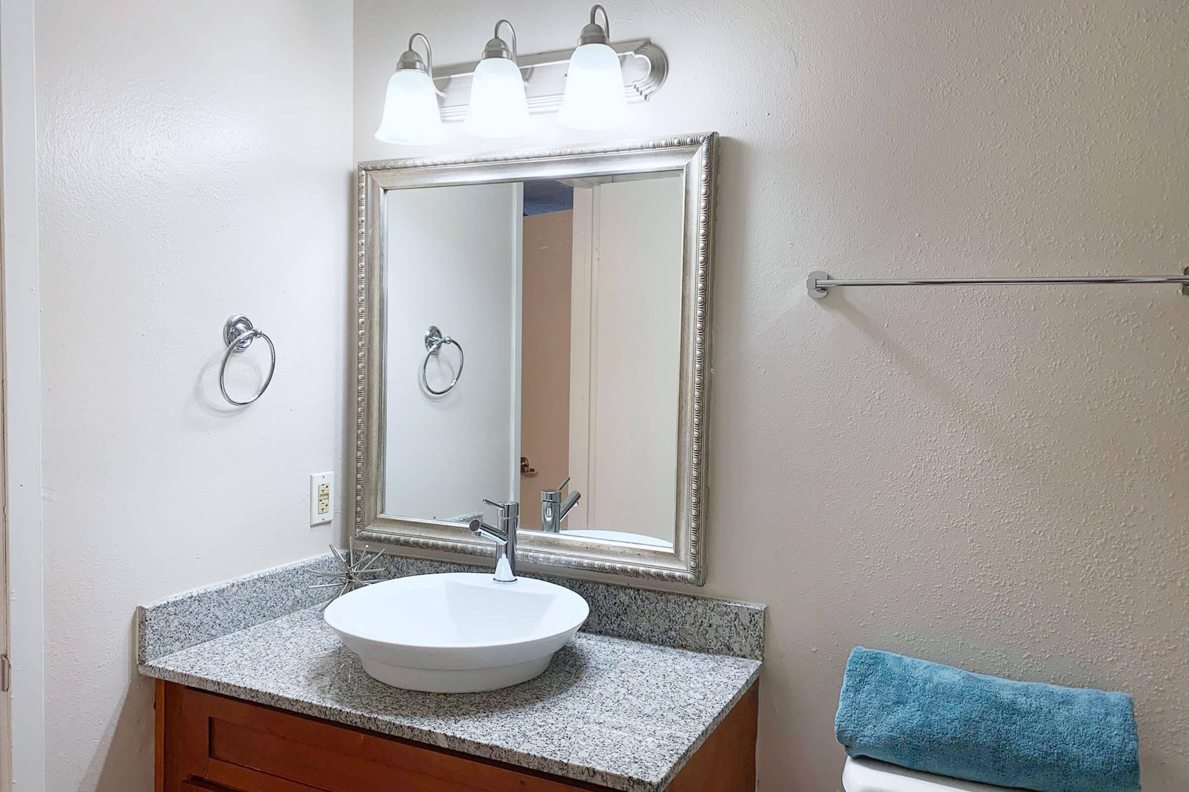 a room with a sink and a mirror