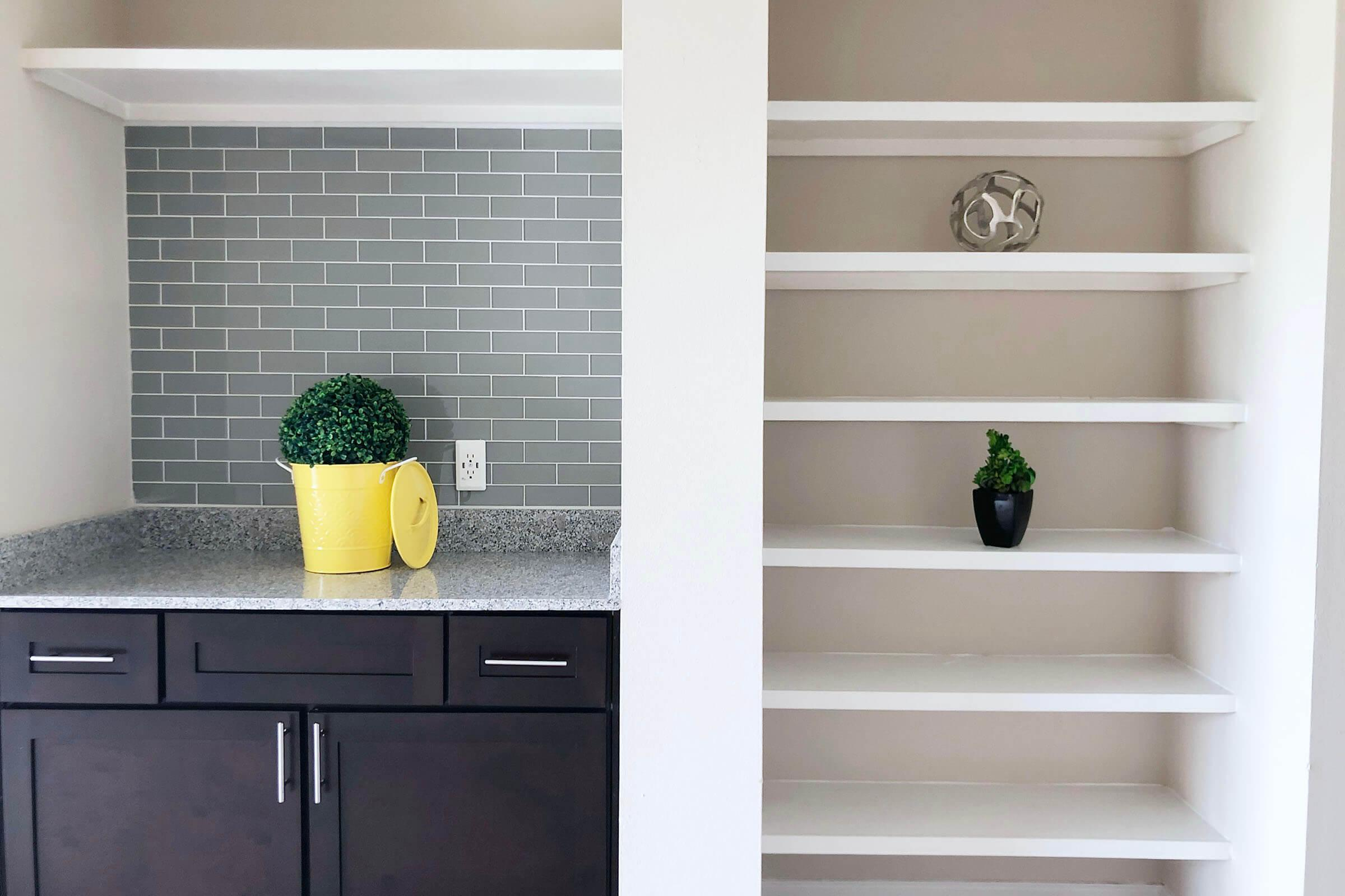 a vase of flowers sitting on a shelf