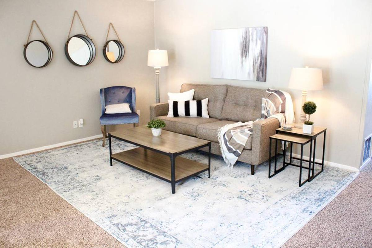 a living room filled with furniture and a table