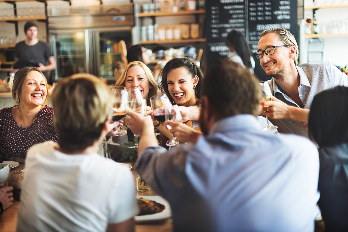 a group of people drinking wine at a restaurant