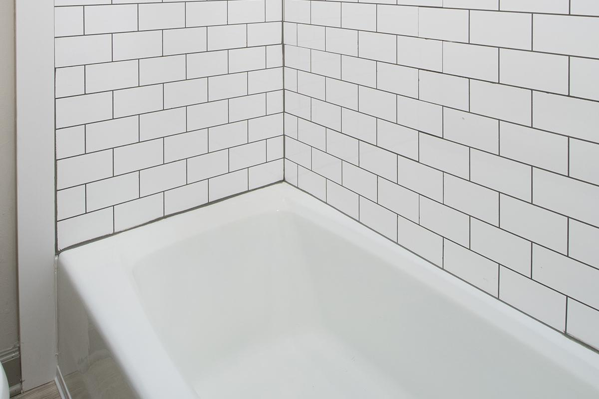 a close up of a white tiled wall