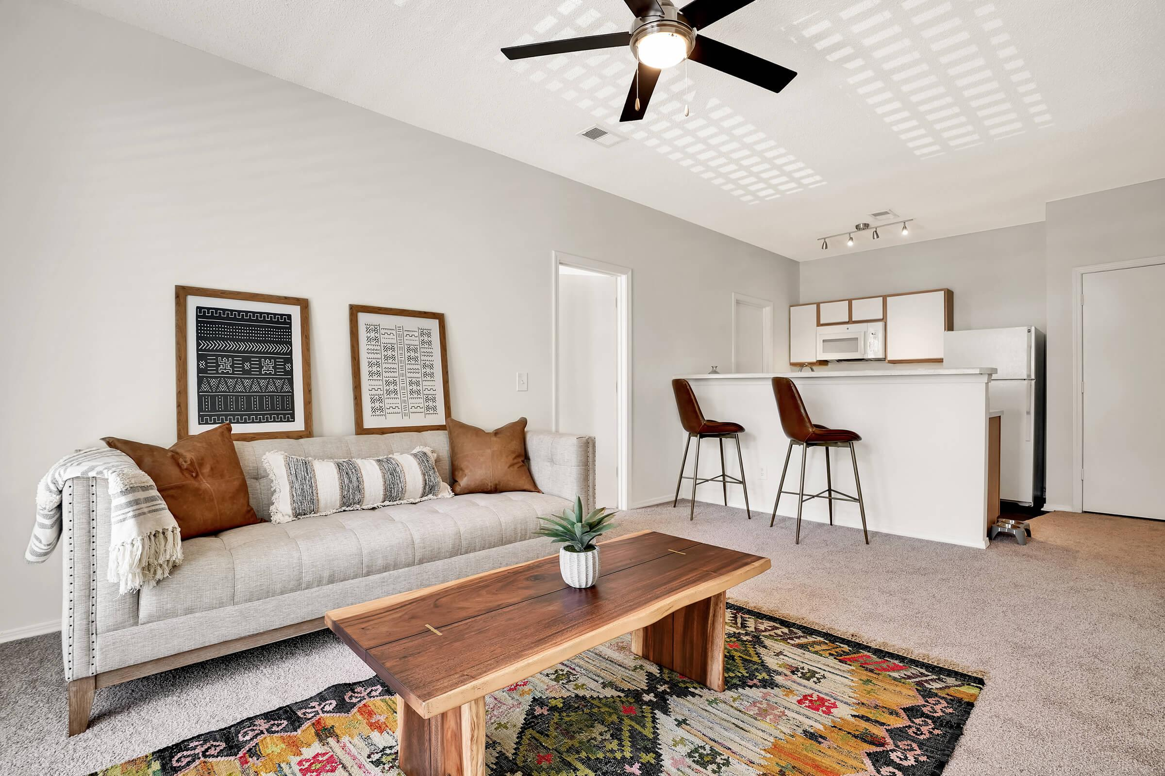 a living room filled with furniture and a rug