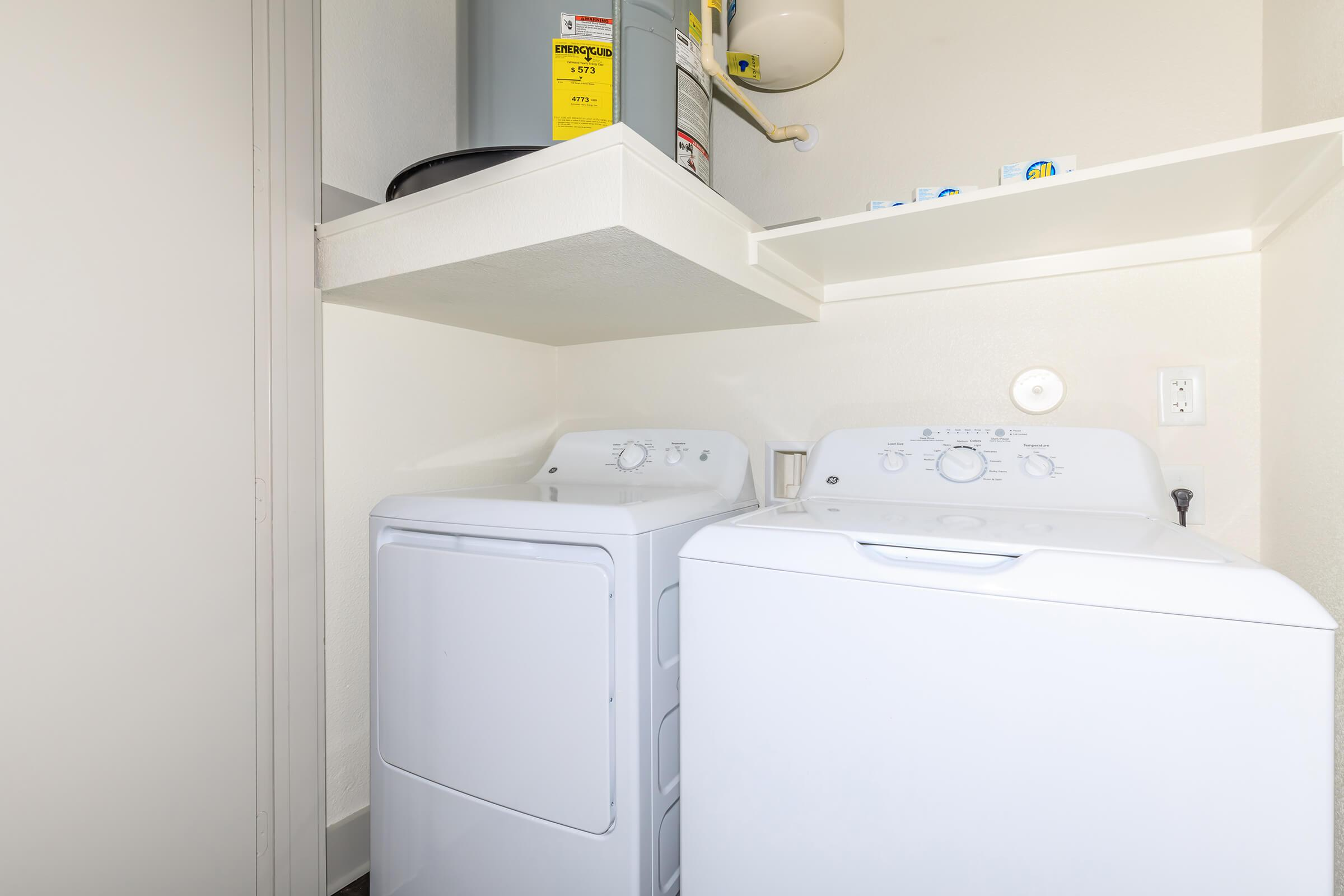 a white refrigerator freezer sitting inside of a box