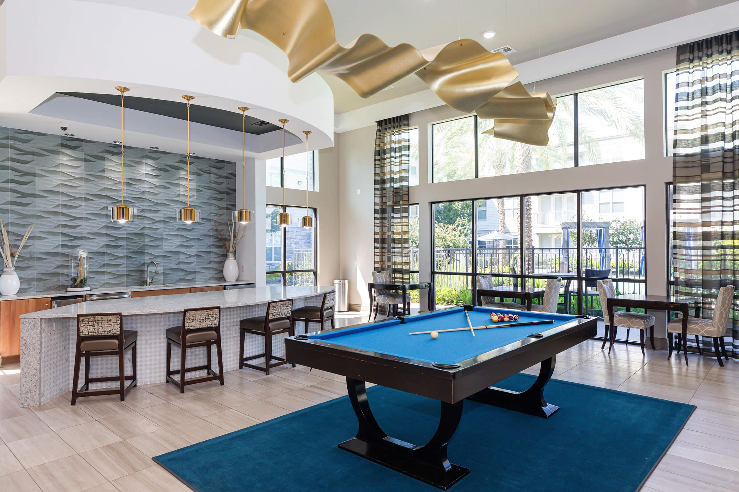 a room filled with furniture and a pool table