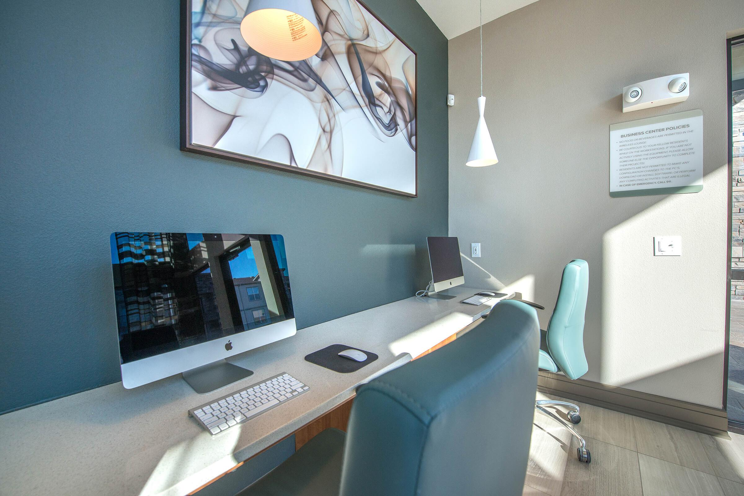 a desk with a computer in a room