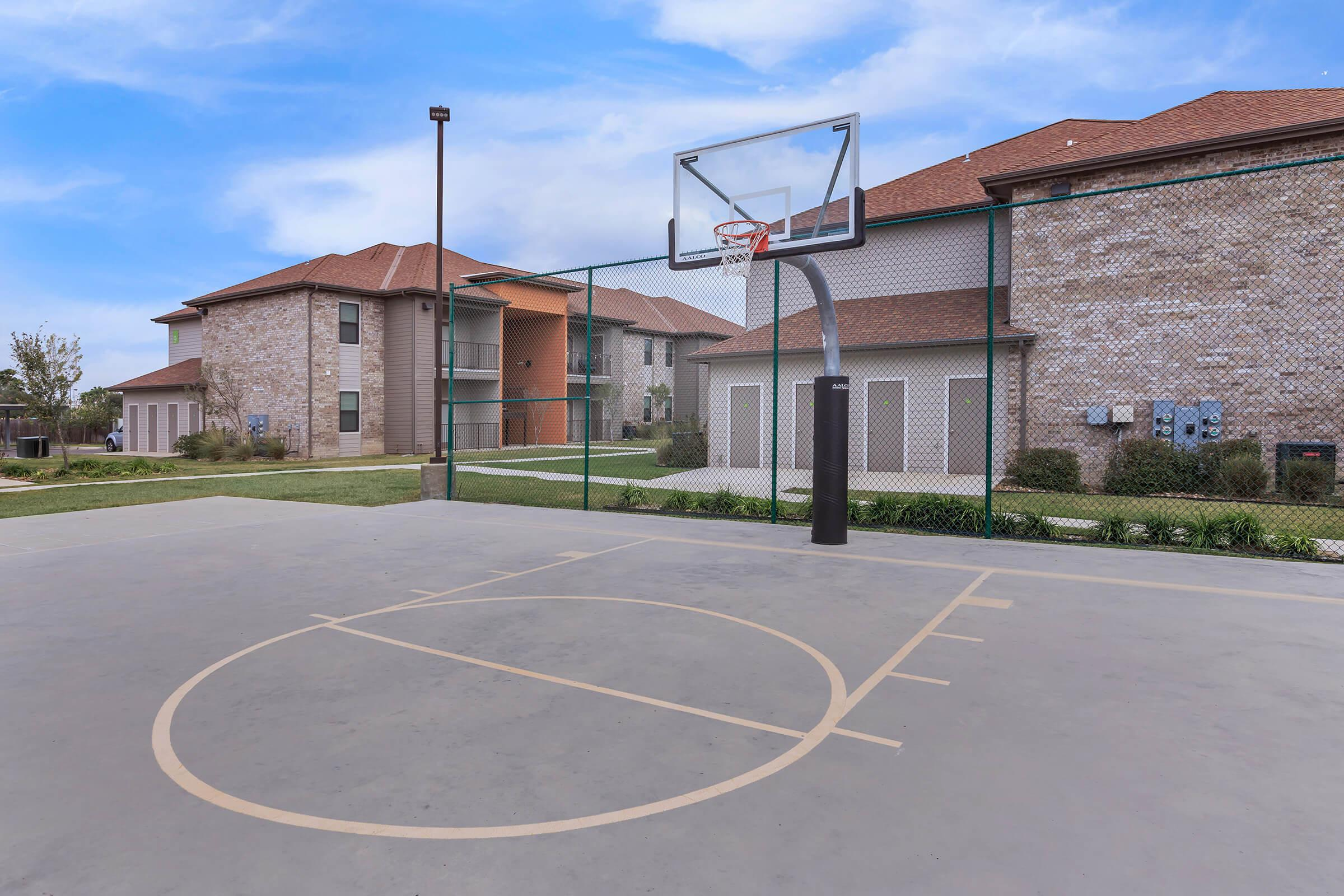 a house with a basketball on a brick building