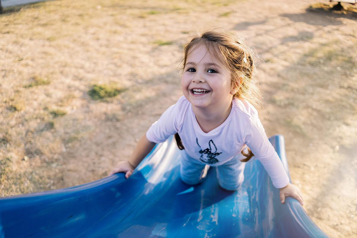 a little girl in a blue shirt
