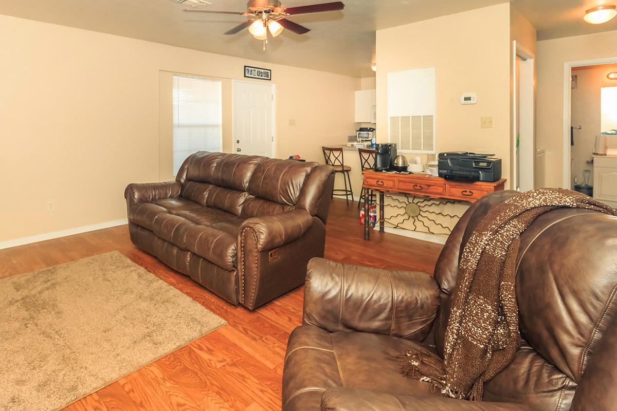a brown leather couch in a living room