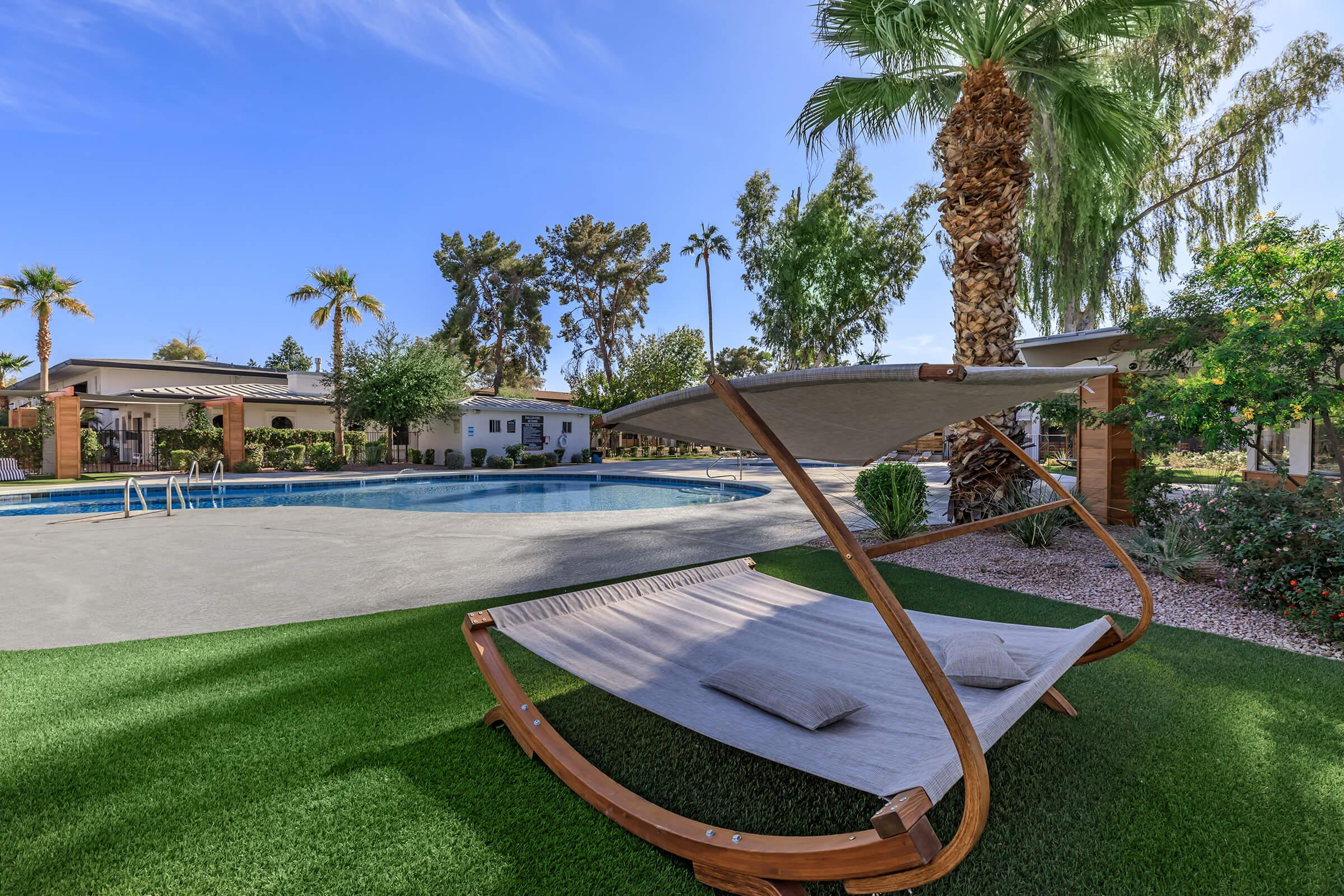 a bench in front of a palm tree