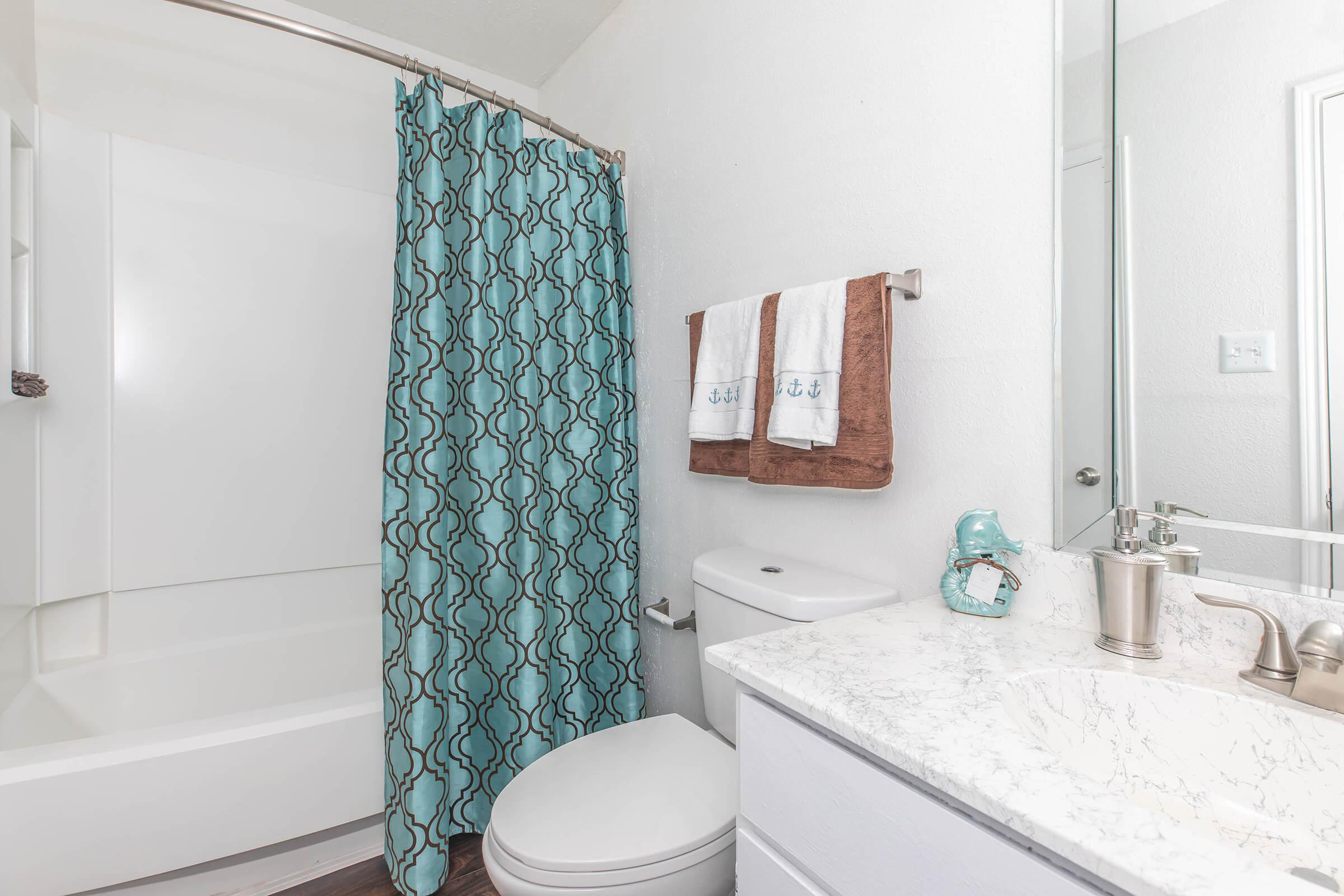 a room with a sink and a shower curtain