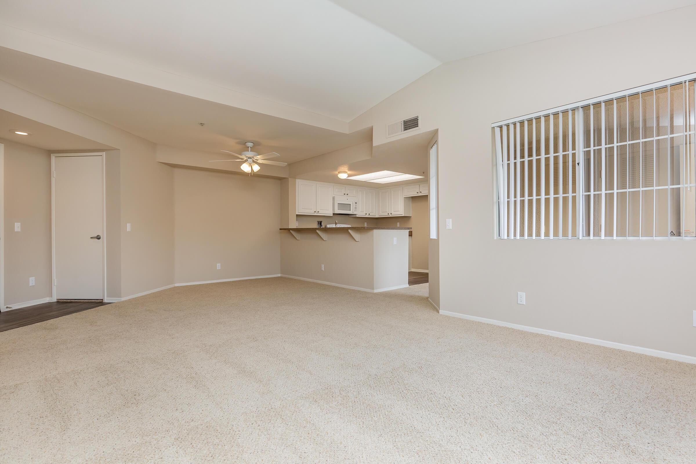 Dining room and living room with carpet