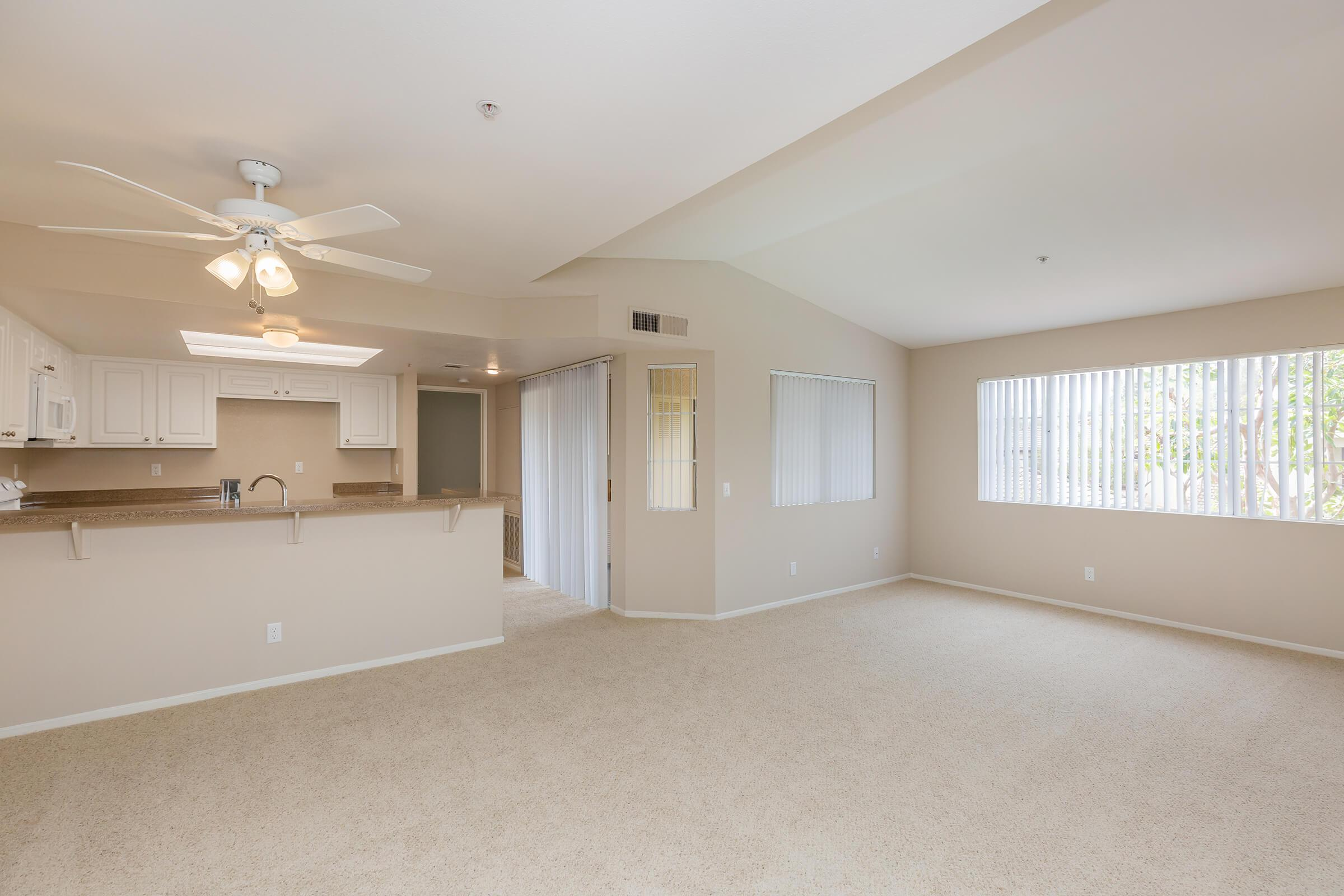 Carpeted living room and dining room