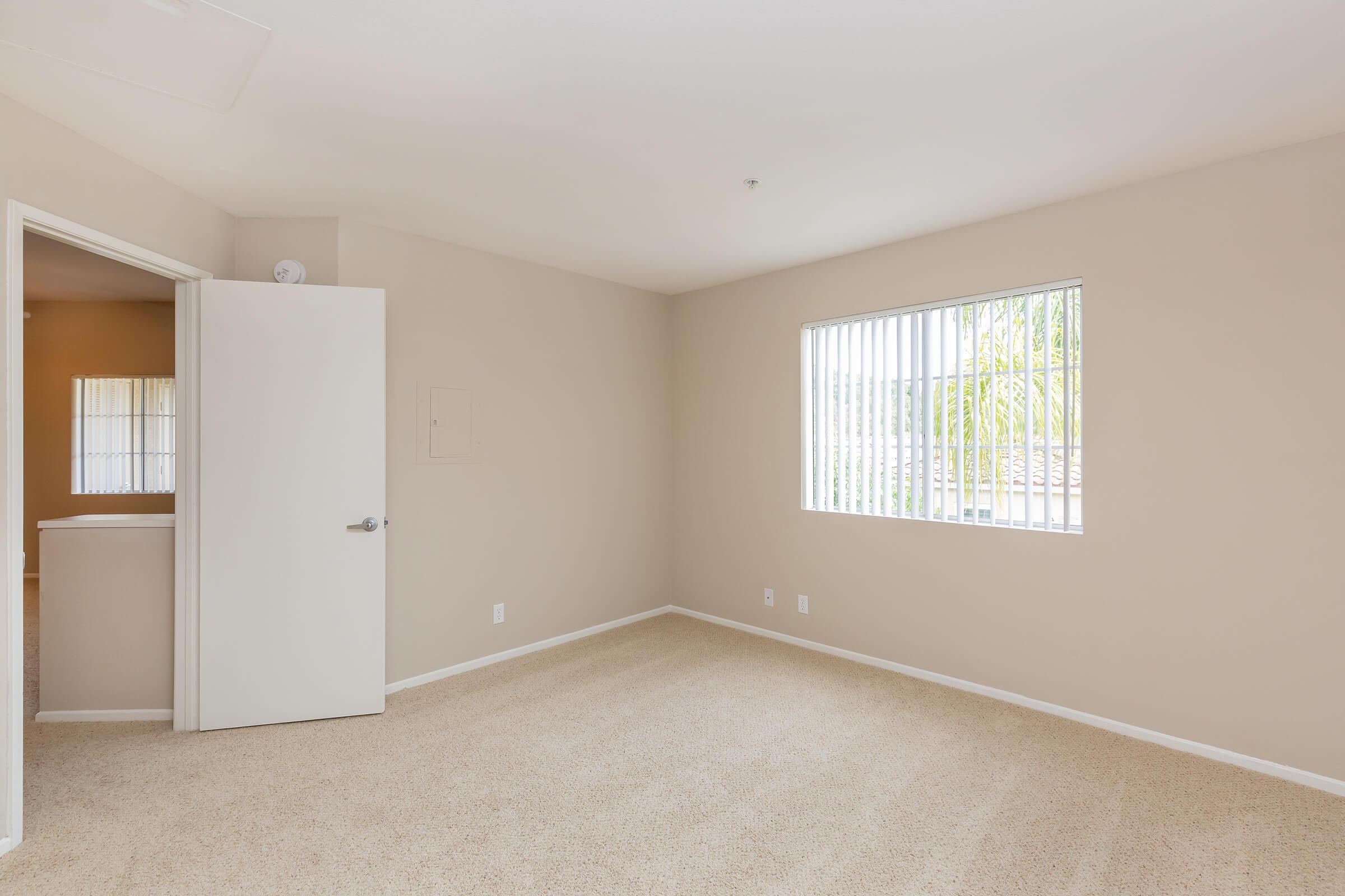 Unfurnished carpeted bedroom