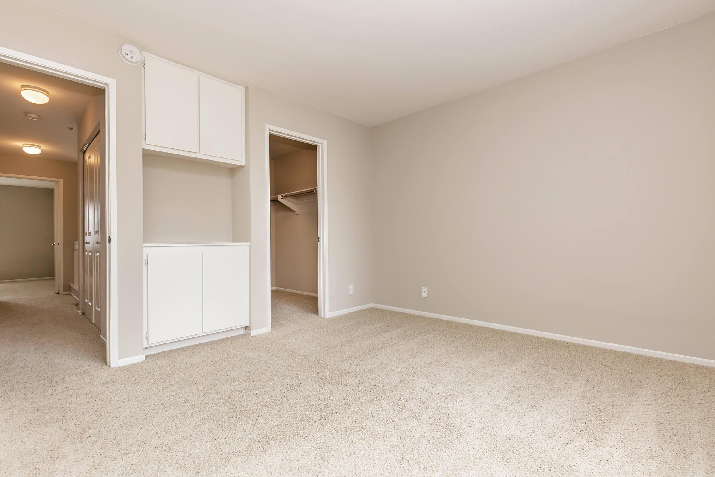 Vacant bedroom with open walk-in closet door