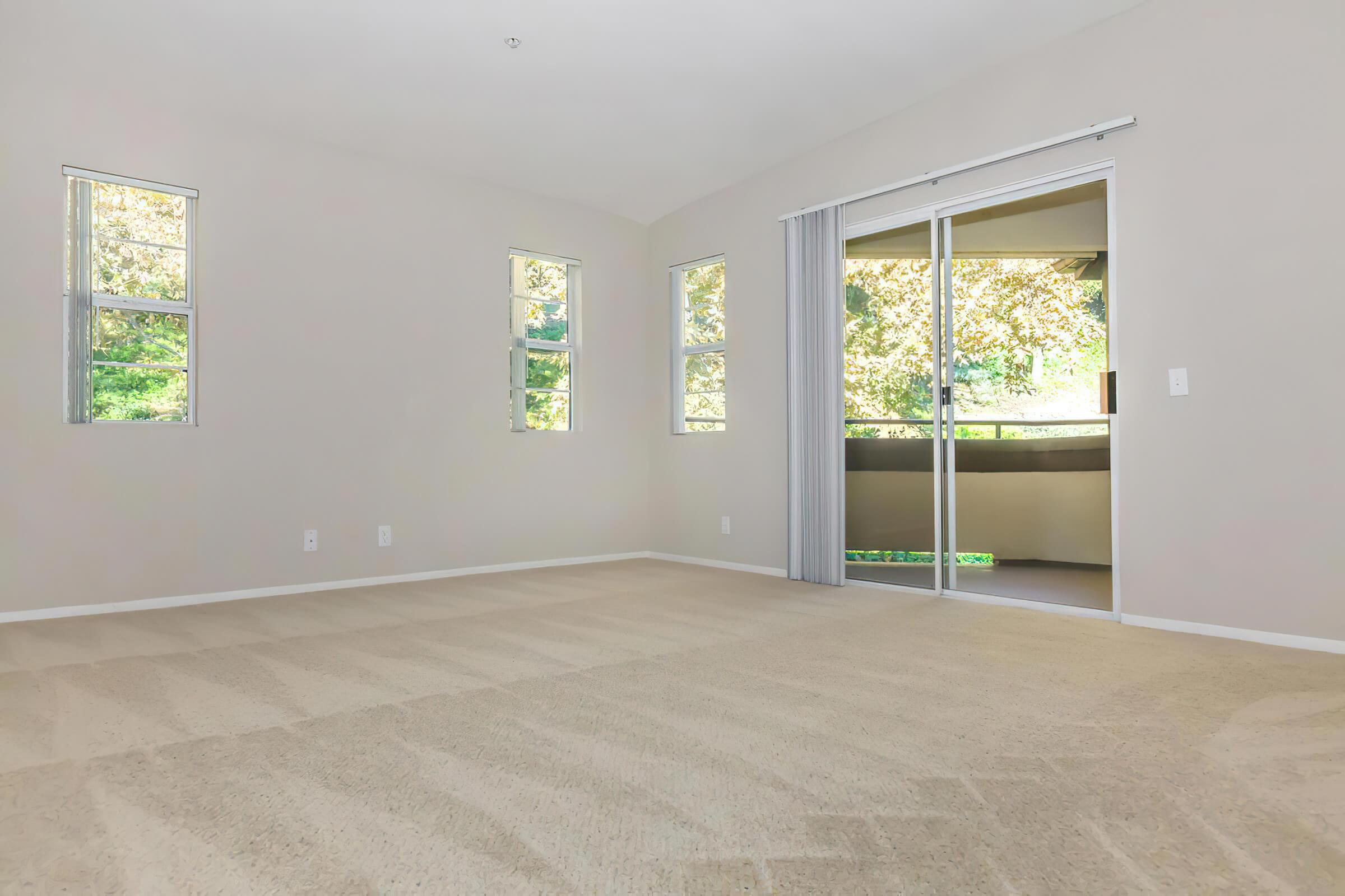 Vacant living room with sliding glass doors