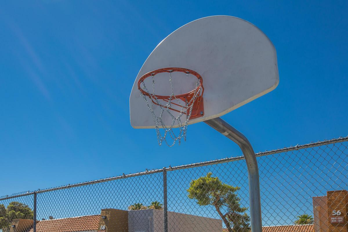 a basketball hoop with a metal fence