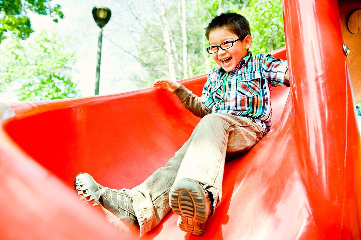 a man holding a slide