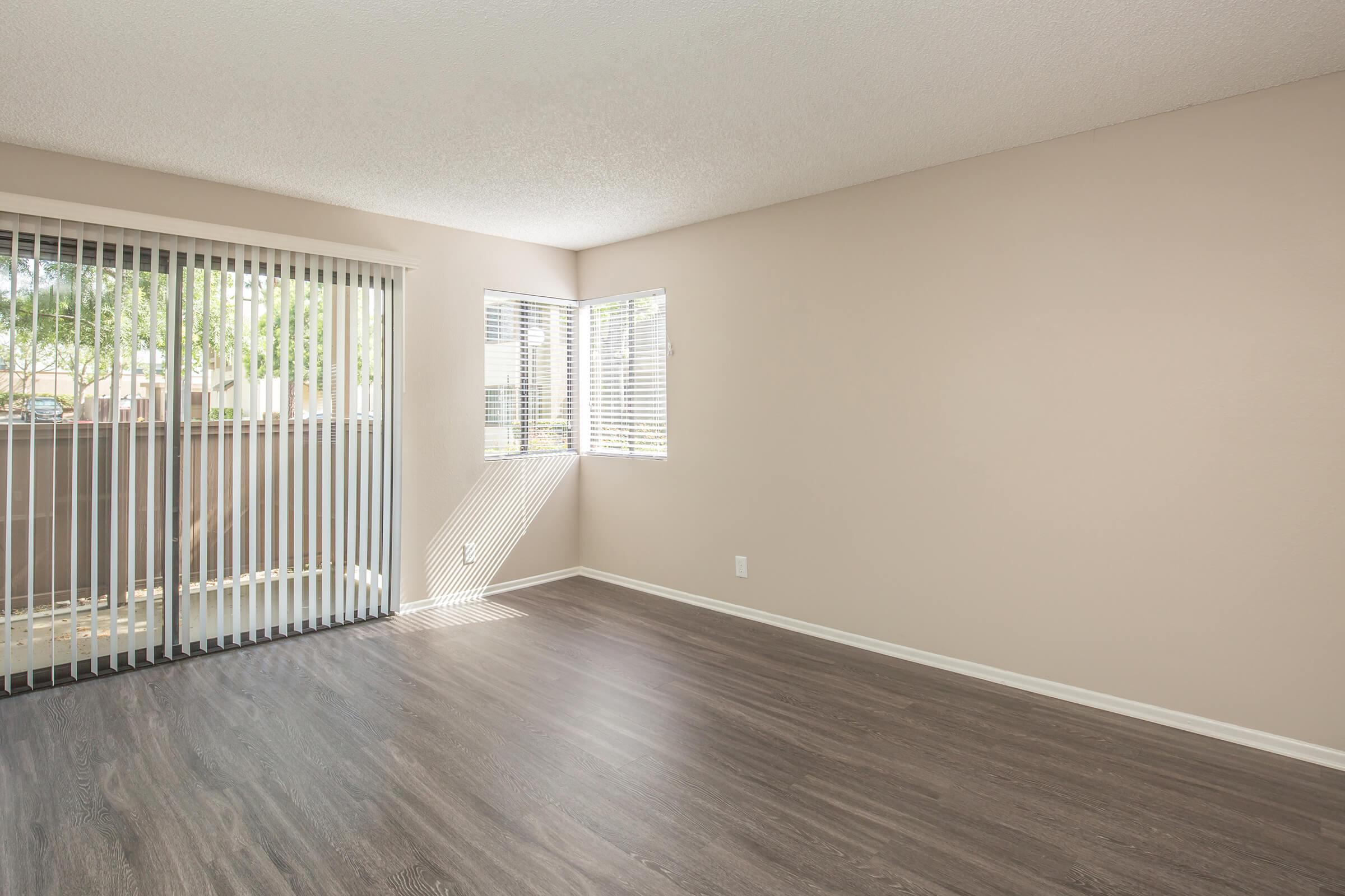 Unfurnished living room with glass sliding doors to patio