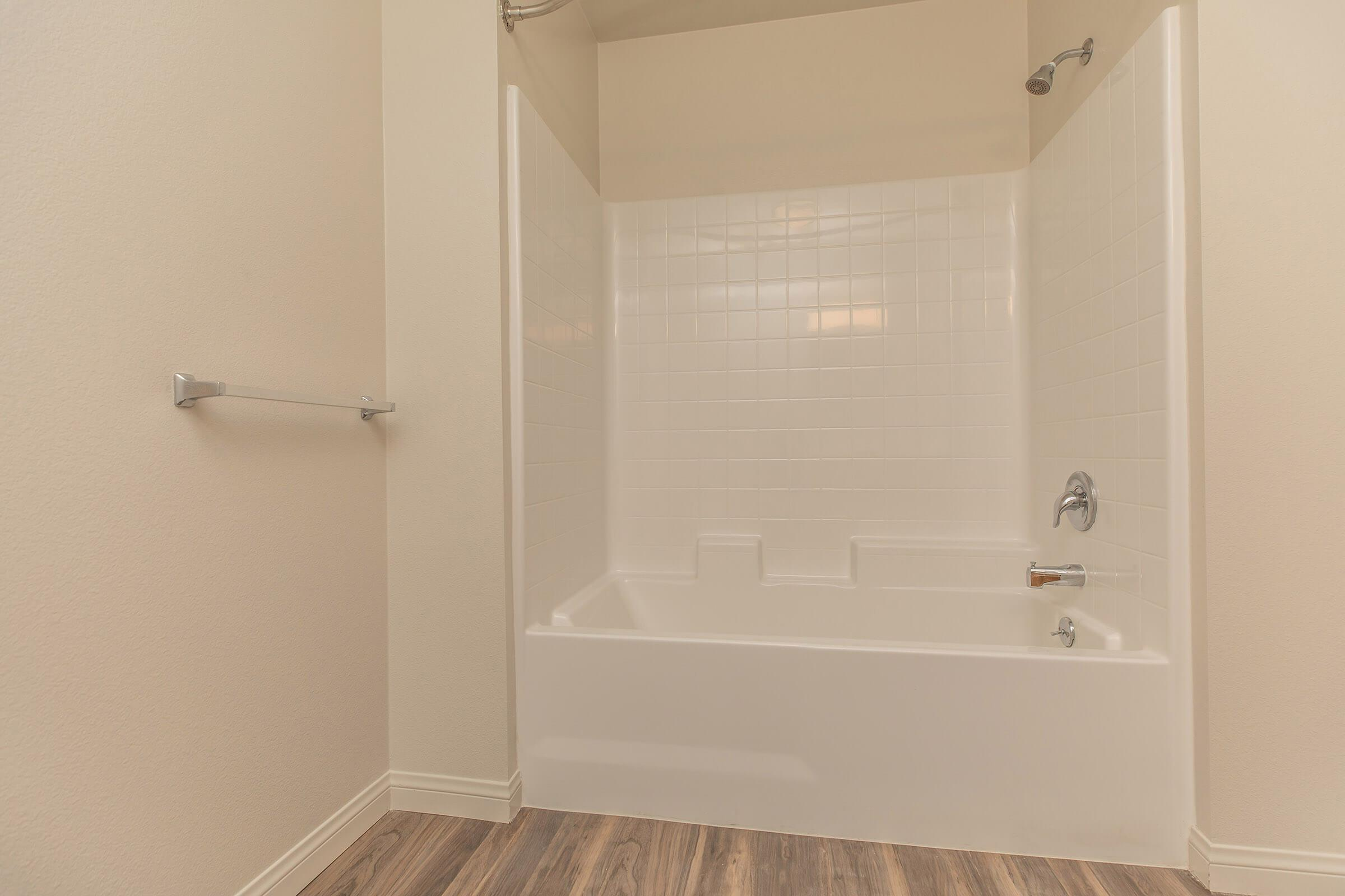 a room with a large tub next to a shower