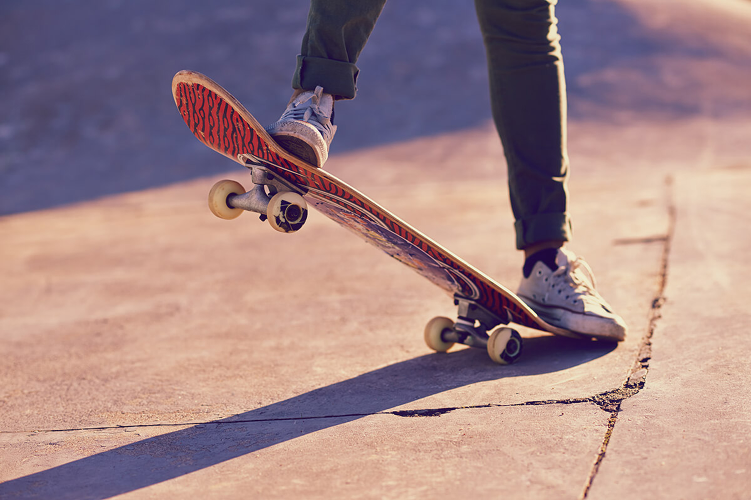 a man riding a skateboard
