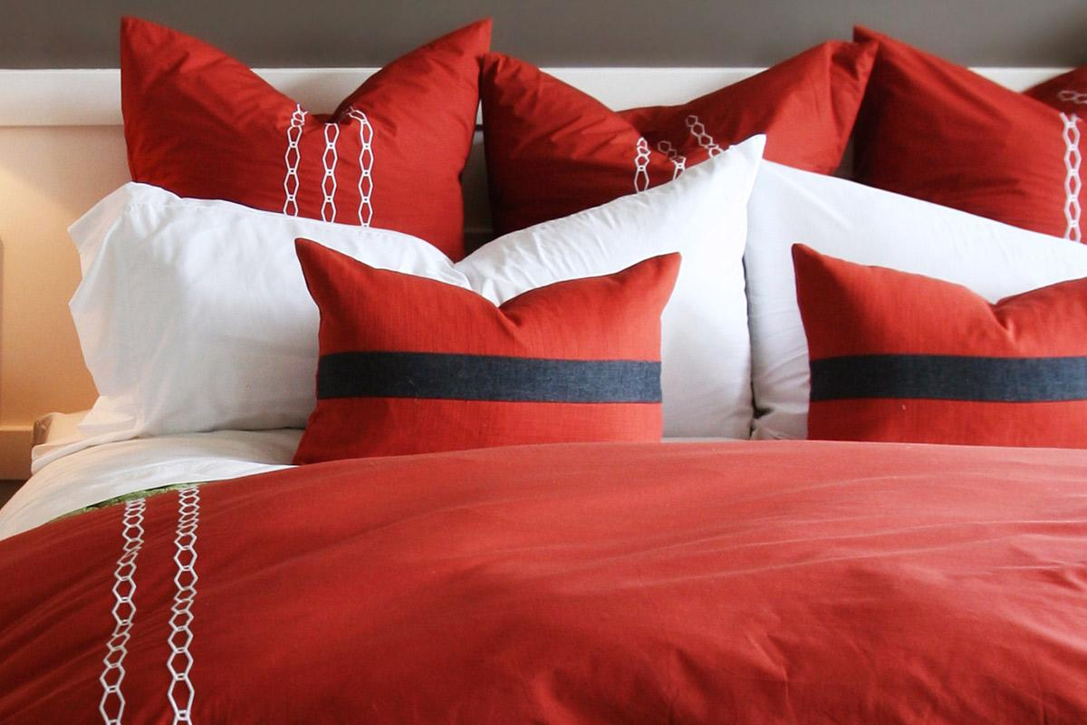 a bed with a red blanket