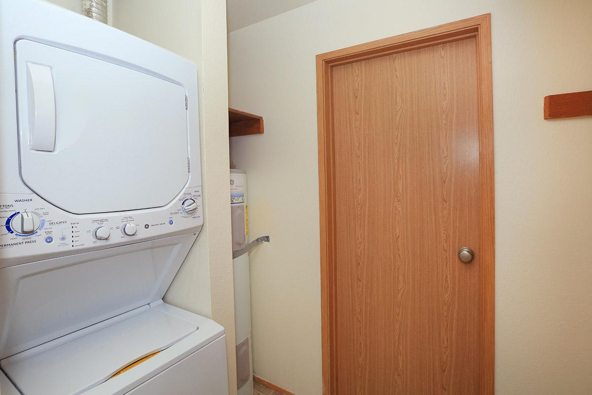 a microwave oven sitting on top of a wooden door