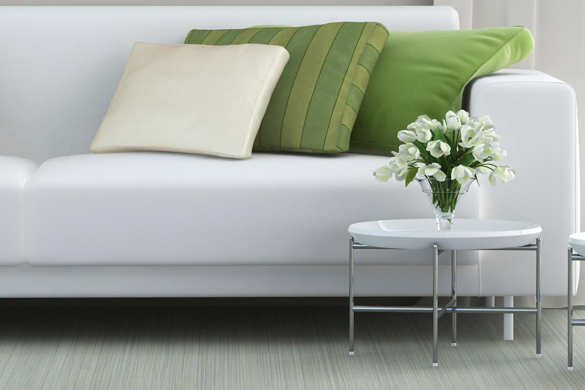 a green sofa in a living room