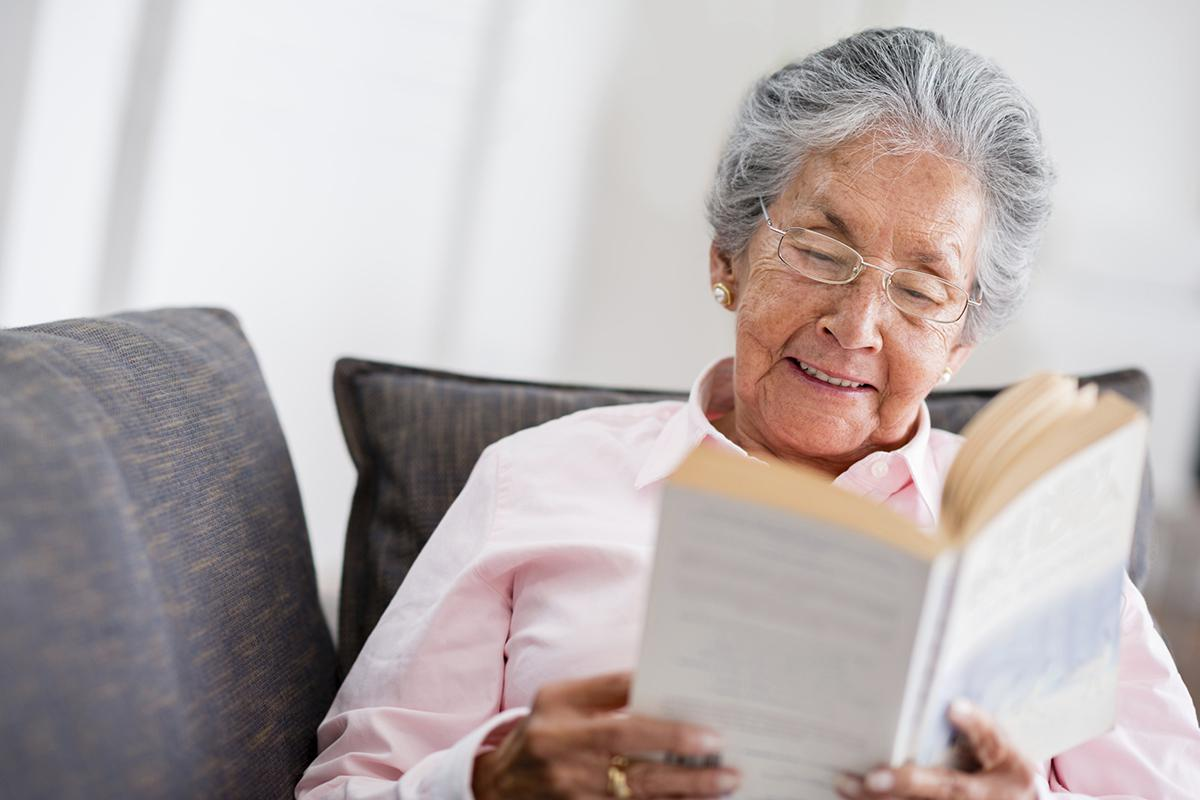 Elder woman reading a book iStock_98845119_LARGE.jpg