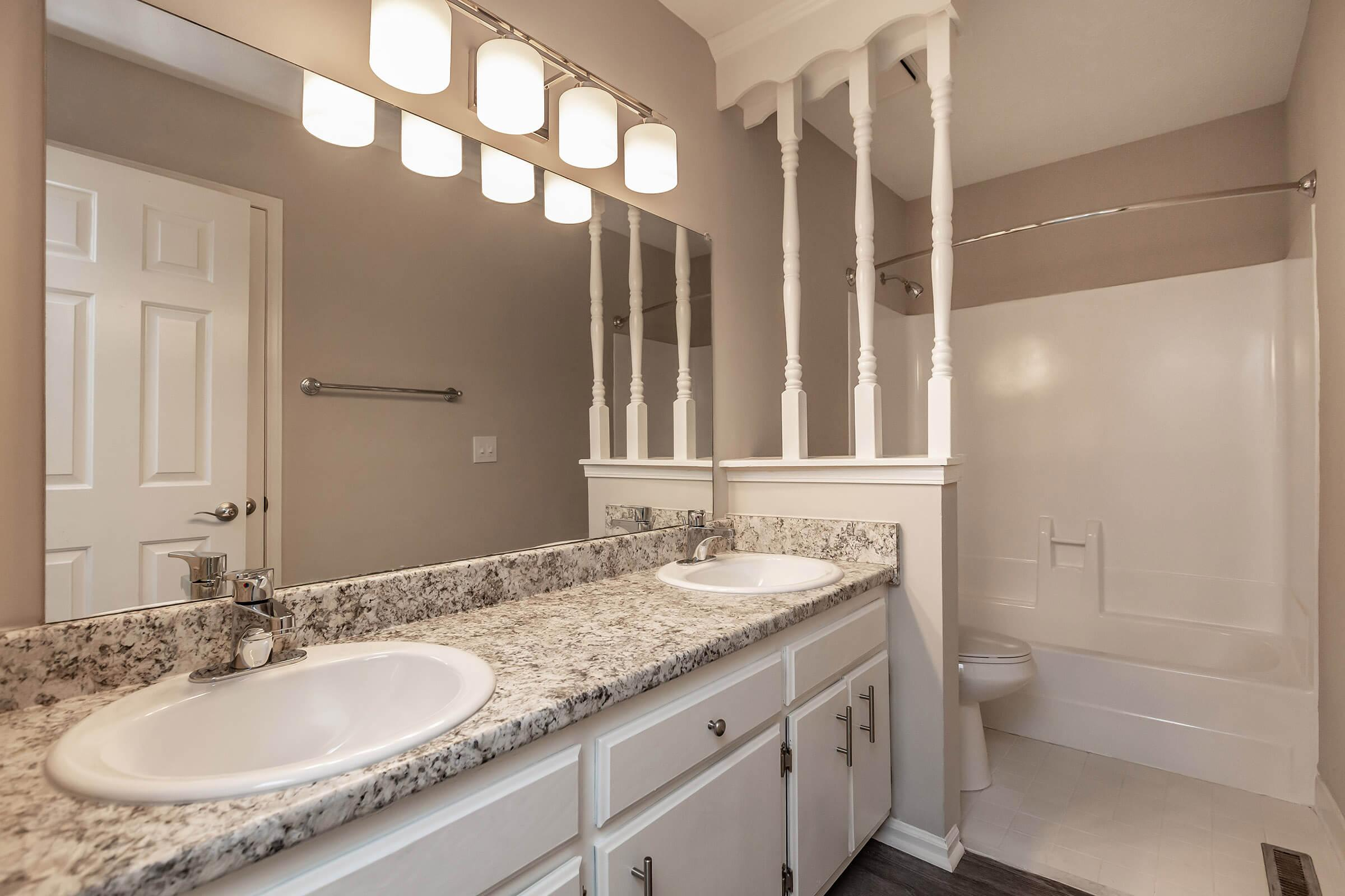 Elegant bathroom at British Woods Apartments