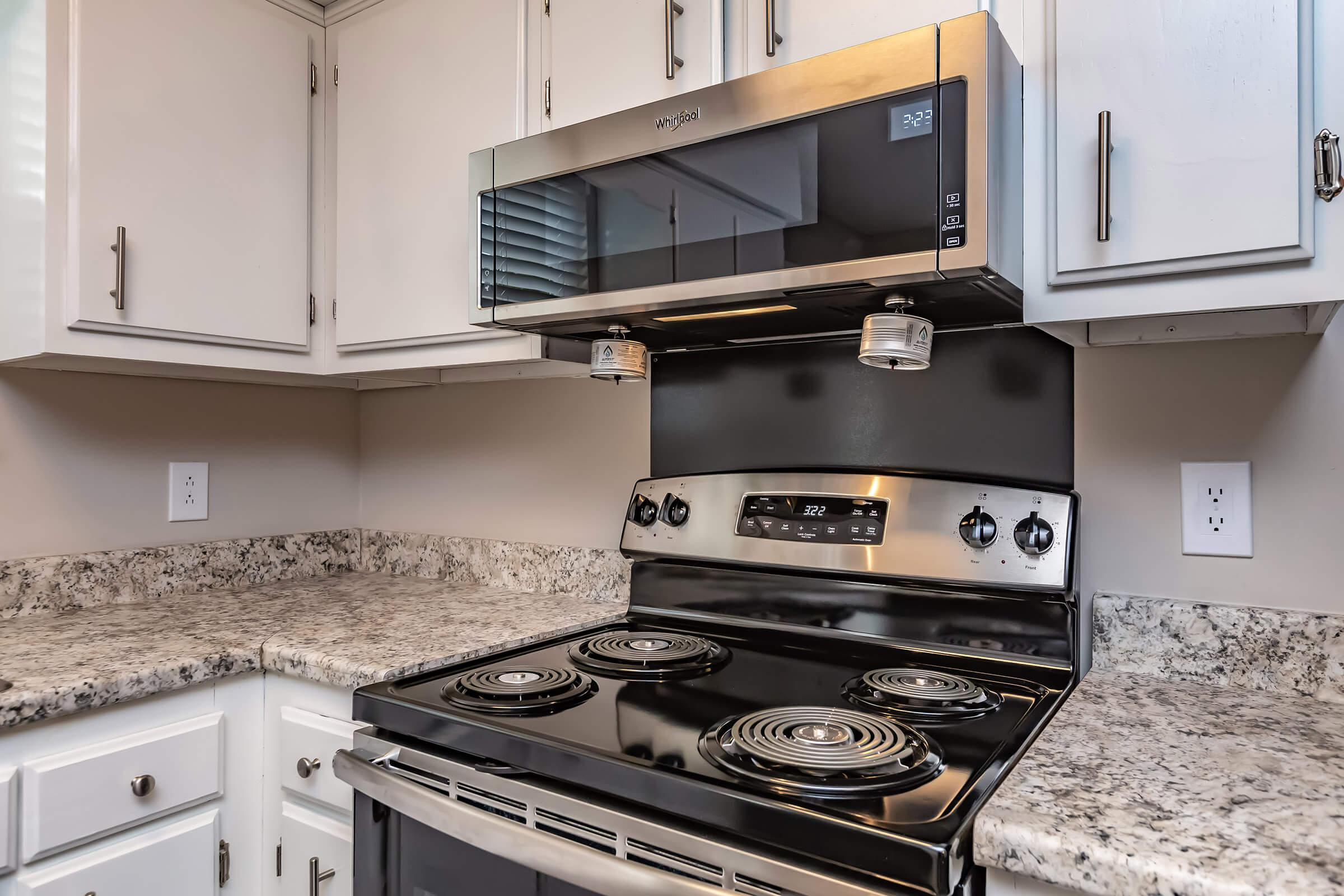 Microwave and range in kitchen of two bedroom townhome
