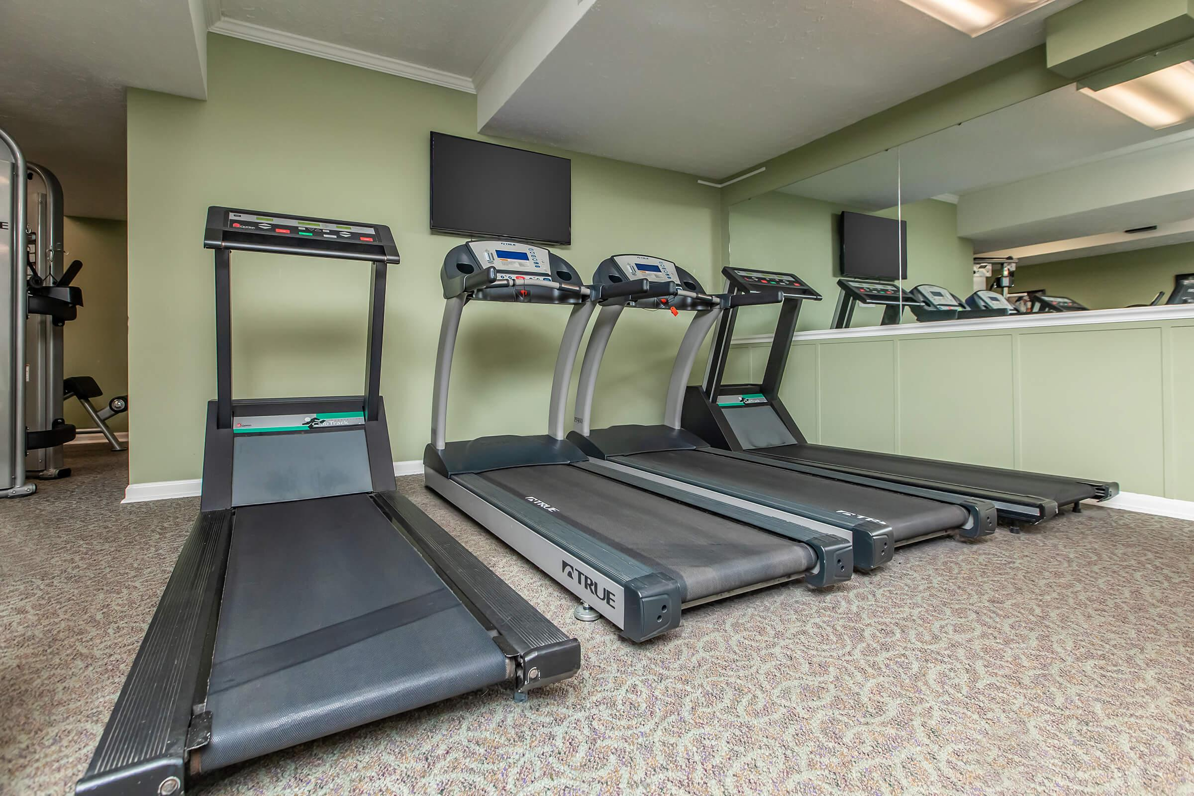 Work out in the fitness center at British Woods Apartments