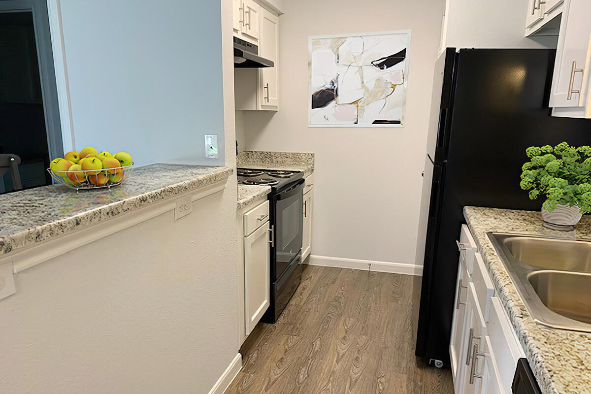 a kitchen filled with appliances and cabinets