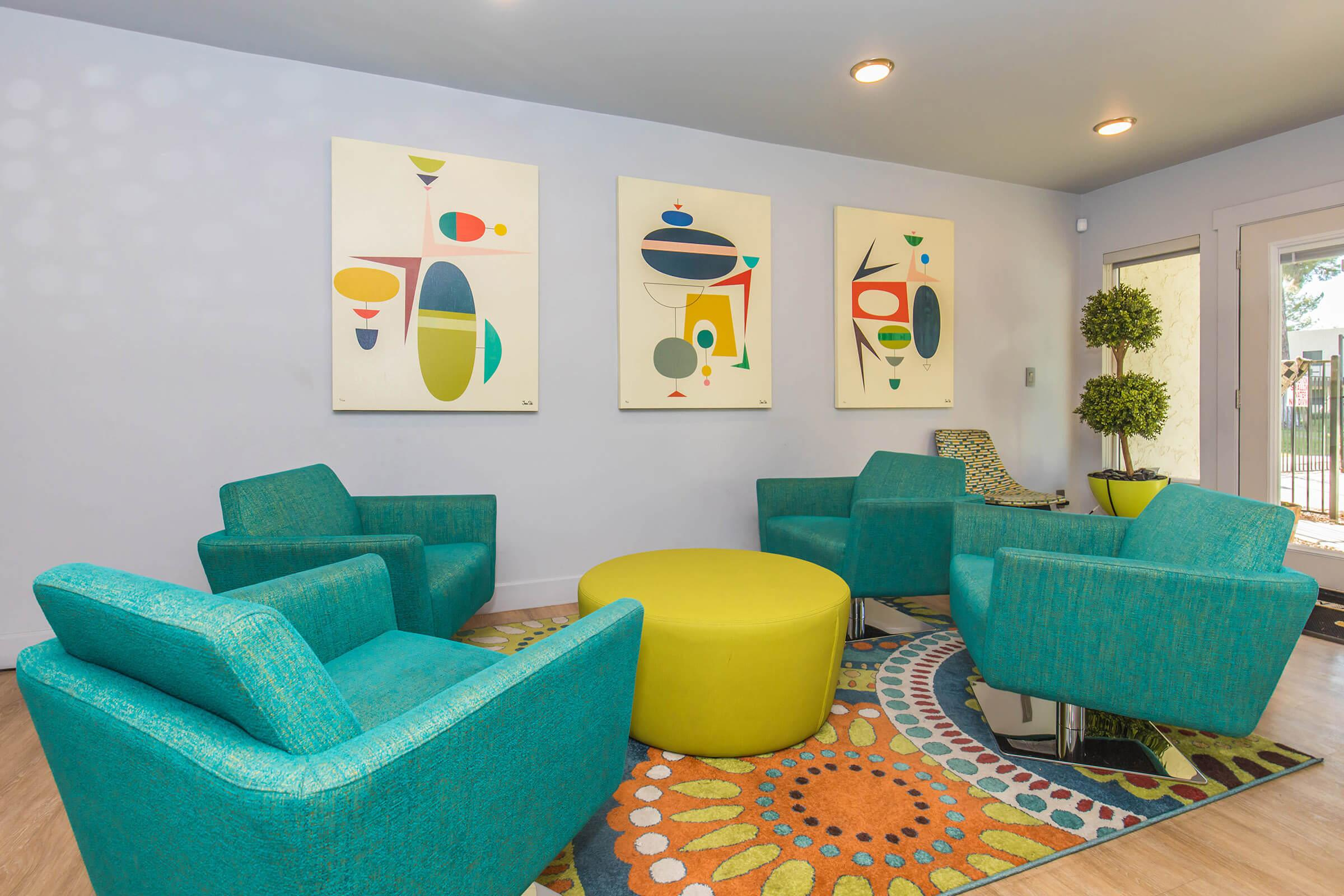 a colorful living room with blue walls