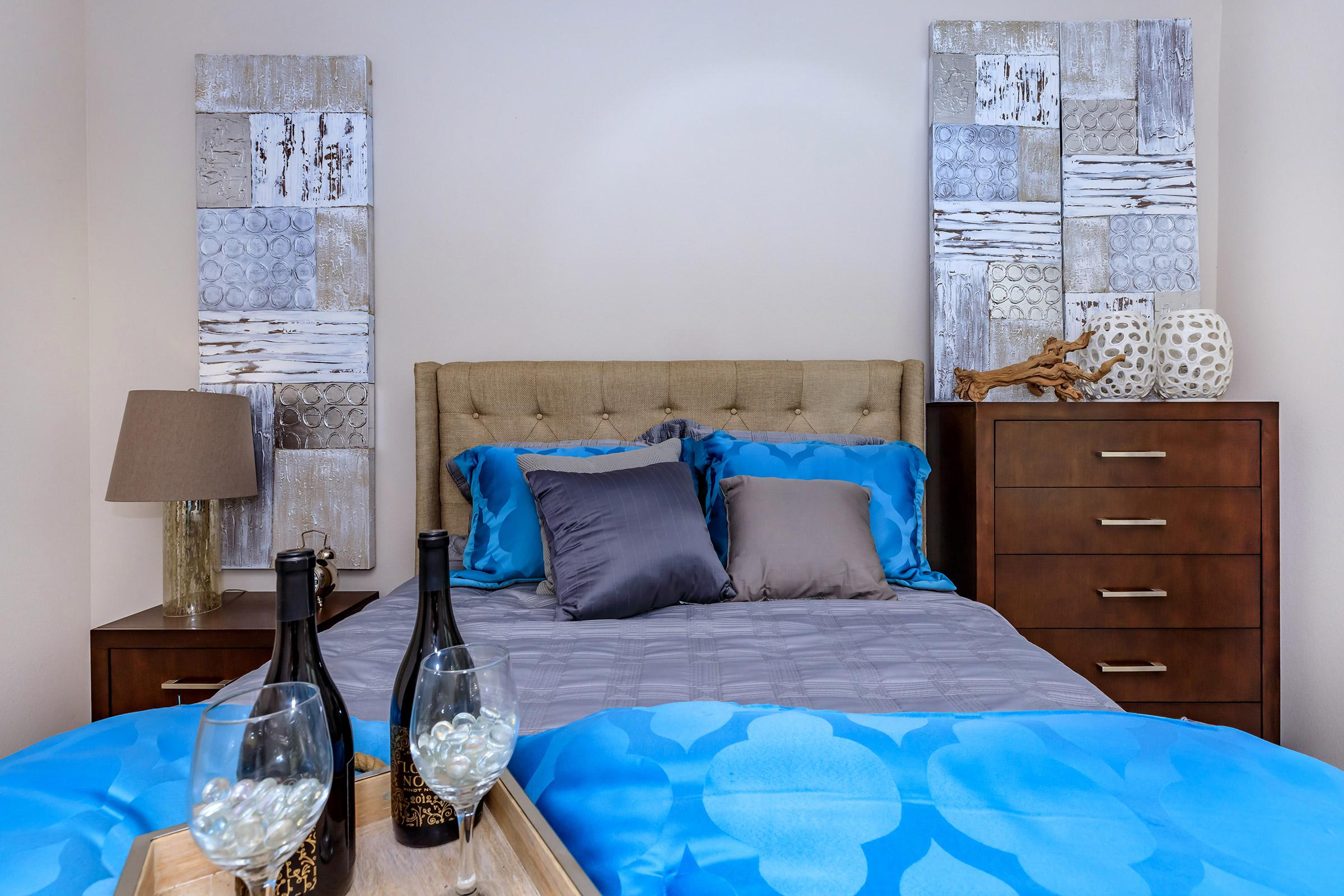 a glass with a blue bed