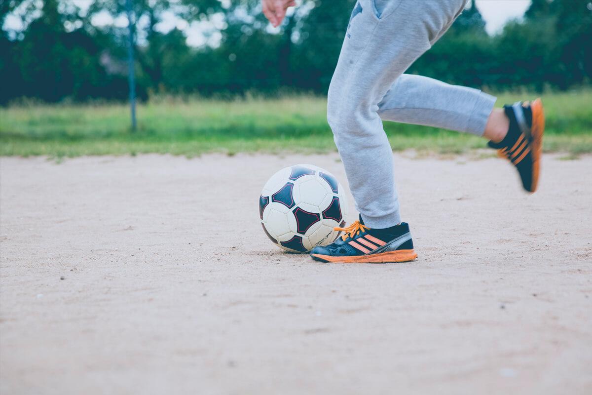 a young boy throwing a ball