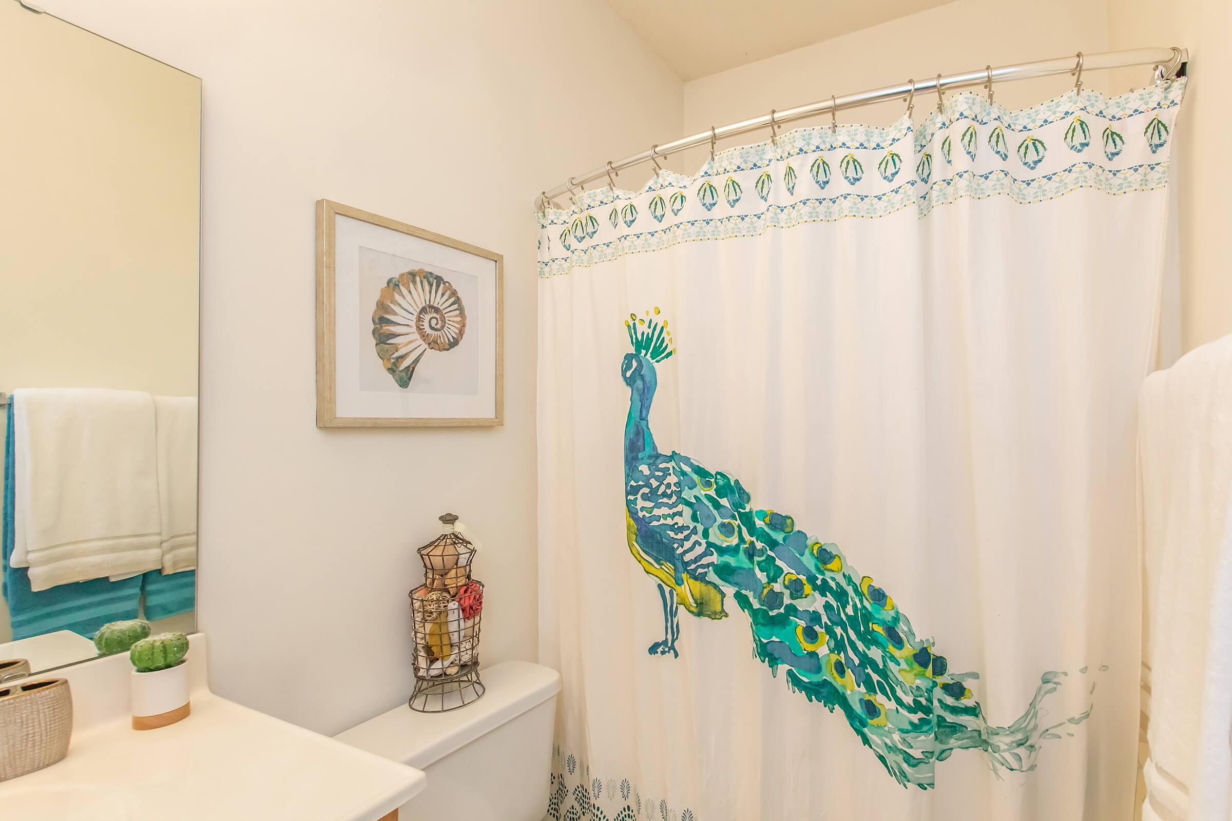 a shower curtain is decorated with white curtains