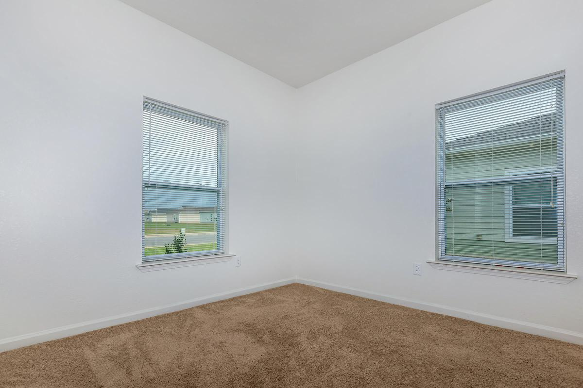 a corner of a room next to a window