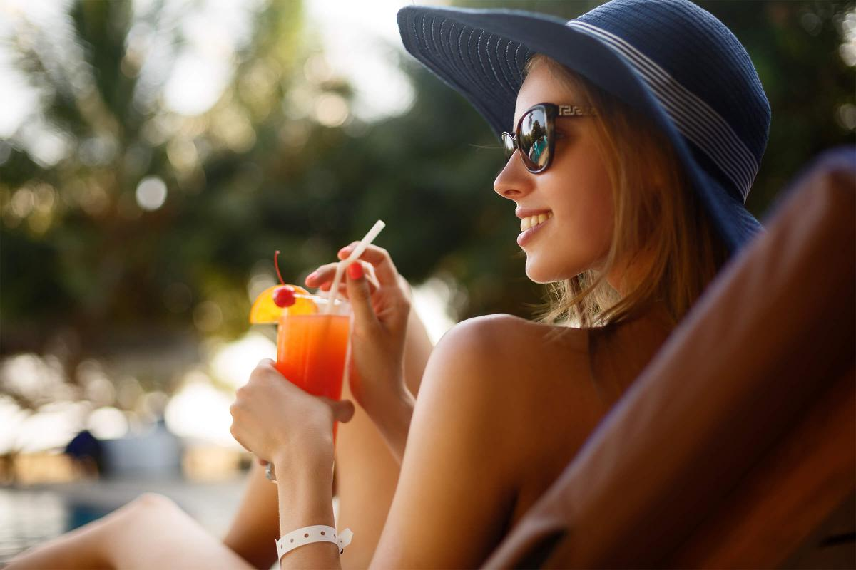 a woman wearing a hat and sunglasses